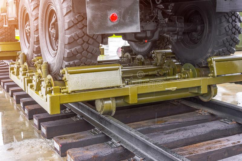 Military equipment truck mounted on rail way.  stock photos