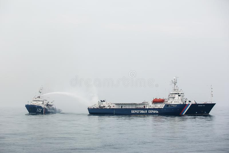 Military exercises of the ships of the border service of Russia to release the captured vessel. stock photography