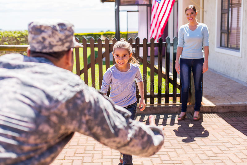Military family reunion. Happy young american military family reunion