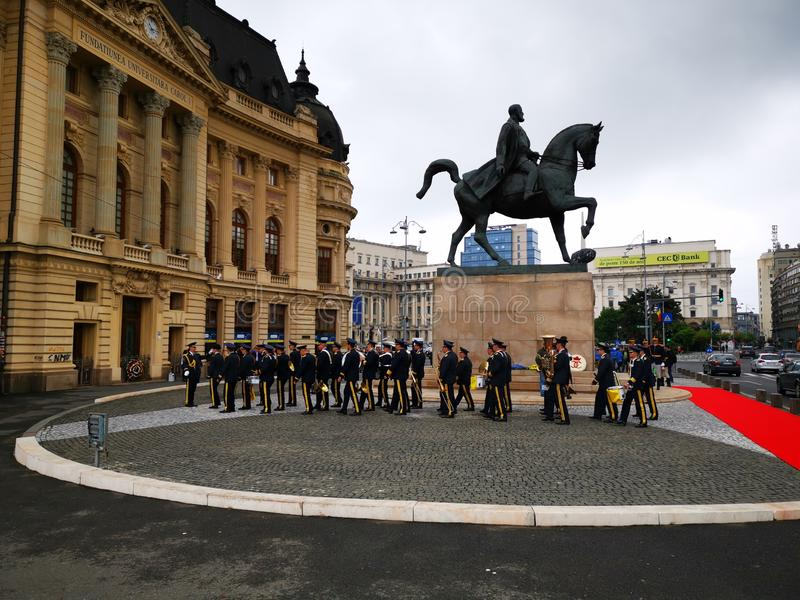 The military fanfare is preparing for the ceremony at the equestrian statue of Carol I royalty free stock photography