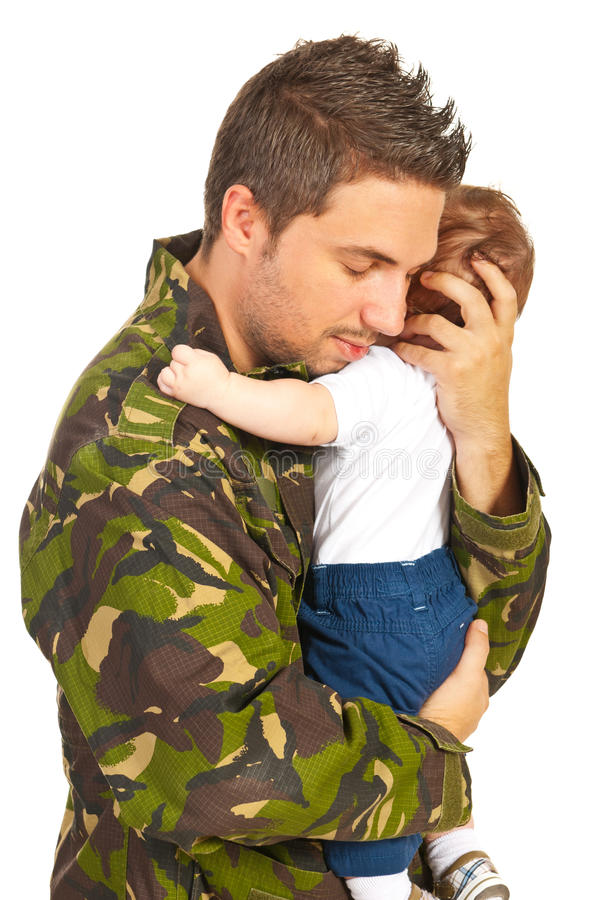 Military father embracing his baby son. Military father embracing his baby boy for first time isolated on white background