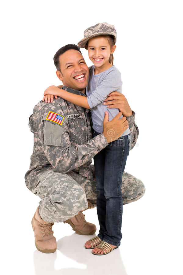 Military father hugging daughter royalty free stock photography
