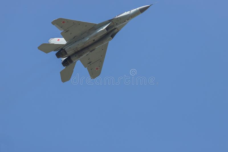 A military fighter jet flying in the sky. Mid shot stock photo