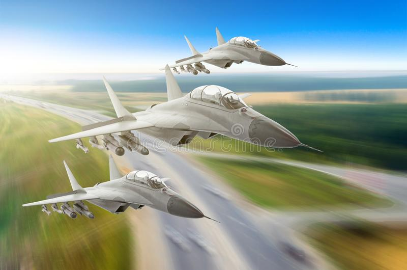 Military fighters jet three group aircraft at high speed above the road and cars approaching low. royalty free stock photos