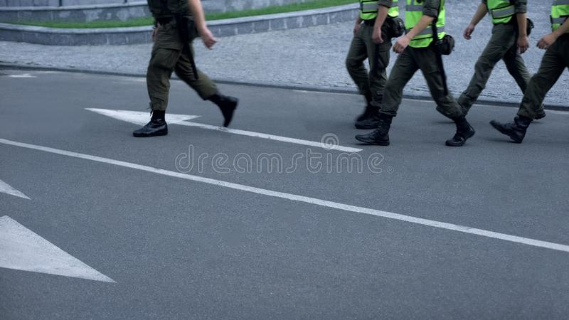 Military force maintains public safety during sport event or festival, patrol. Stock photo stock images