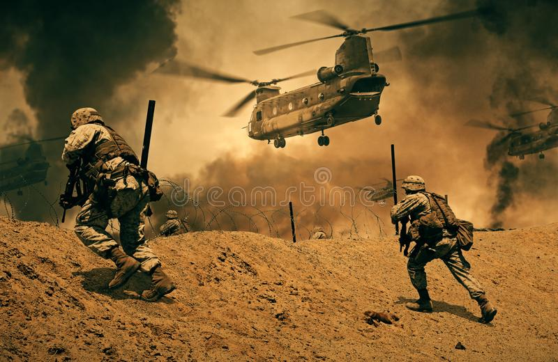 Military forces and helicopters between fire stock photo