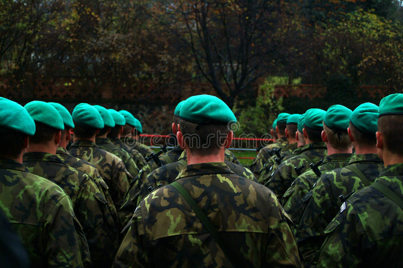 Military green Beret parade, fatigues. Military and Police parade in Prague Czech republic. AK-47 rifle gun. military onset. boarding. green Beret, fatigues stock photography