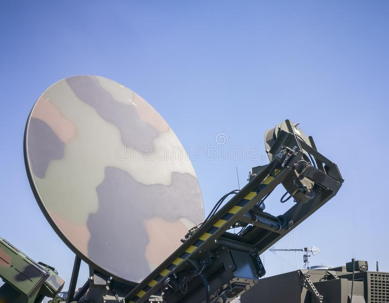 Military ground satellite antenna. Military ground antenna with parabolic dish and satellite transmission module , army camouflage pattern of an army combat unit royalty free stock photography