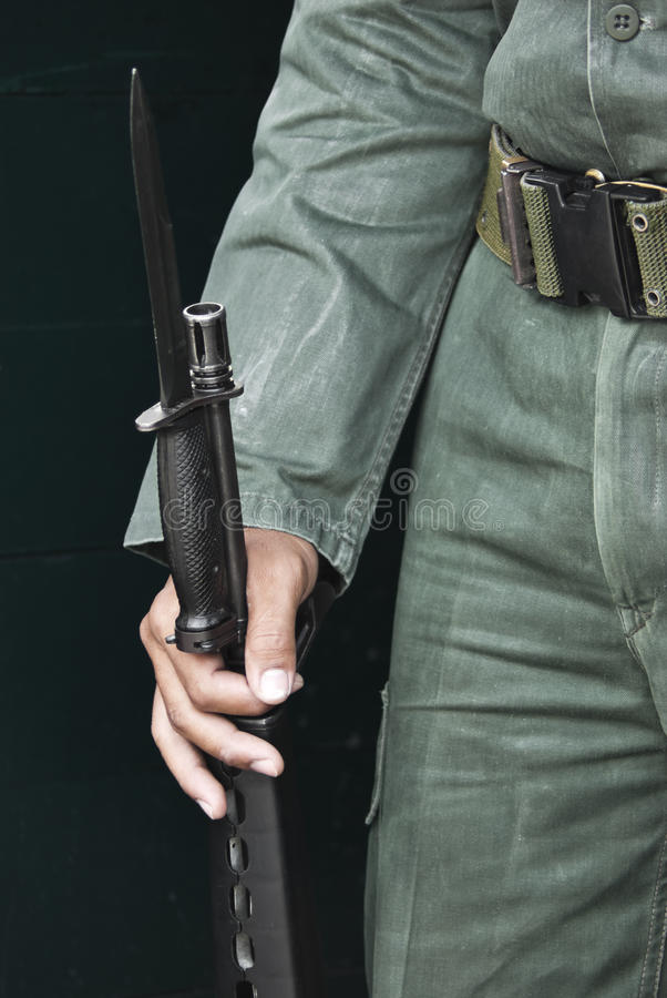 Military Guard With Bayonet. Hand of A Military Guard in Thailand royalty free stock image