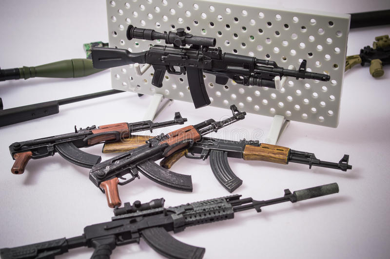 Toy Swords And Guns : Military gun toy backgrounds stock photo image of rifle