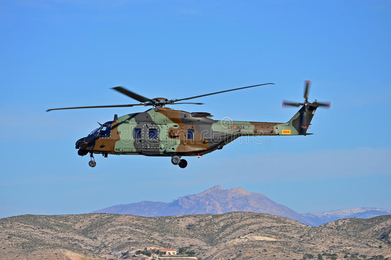 Military Helecopter. An army helicopter on patrol in the hills next to Alicante Airport stock image
