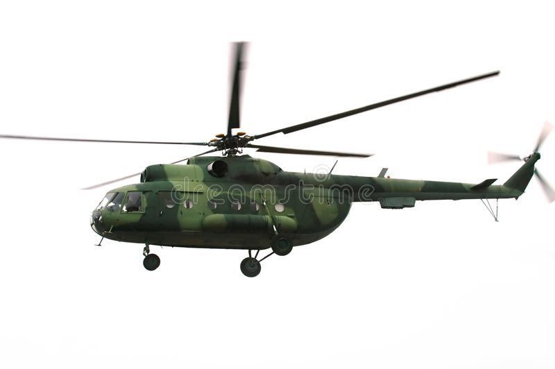 Military helicopter. Flying military helicopter in the sky stock images