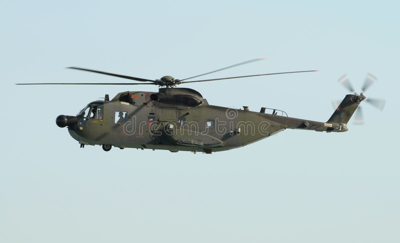 Military helicopter. Hovering during an exhibition stock images