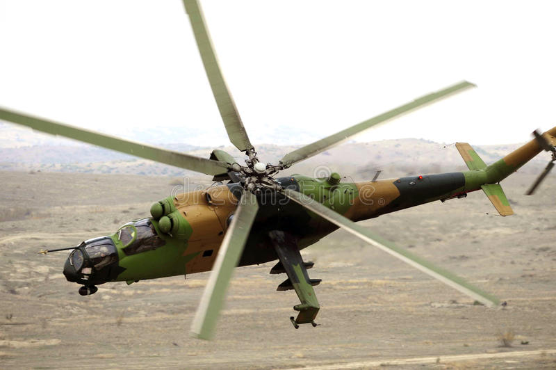 Military helicopter in action royalty free stock photography