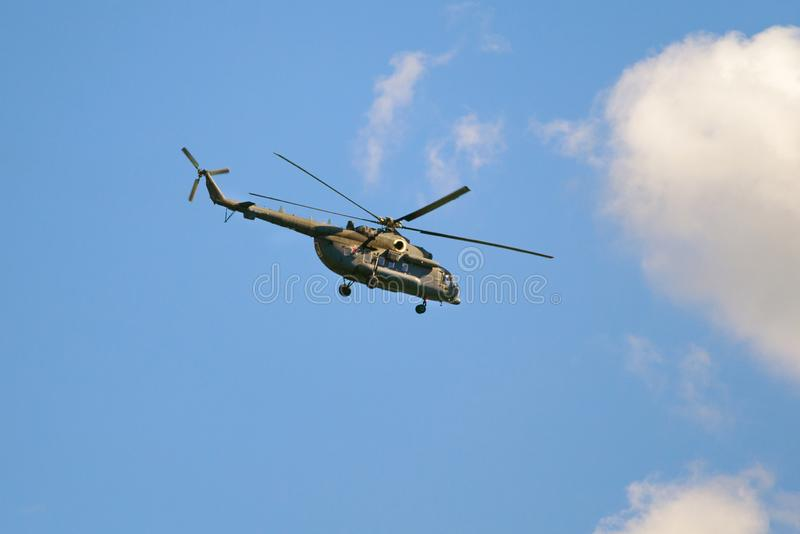Military helicopter of the Air Force of the Russian Federation in the blue sky editorial royalty free stock photography