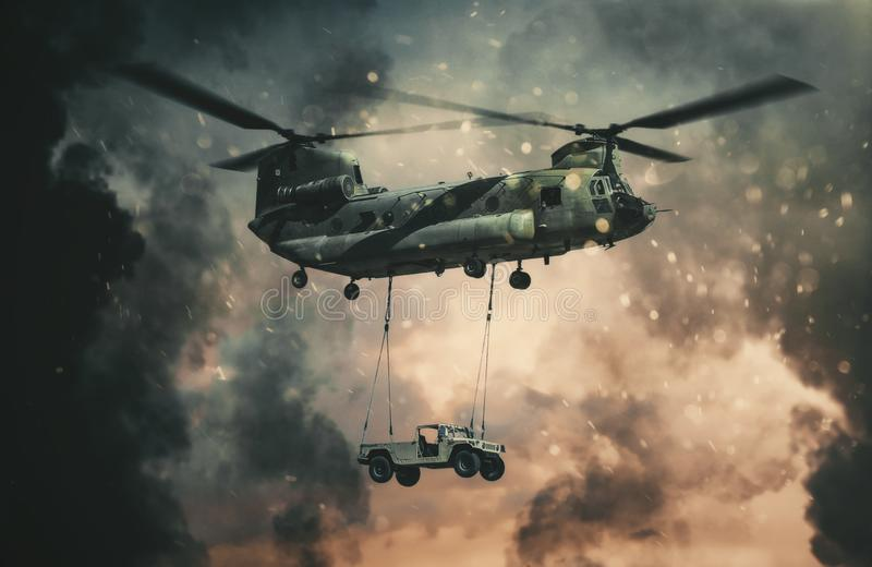Military helicopter carrying car between fire stock photo