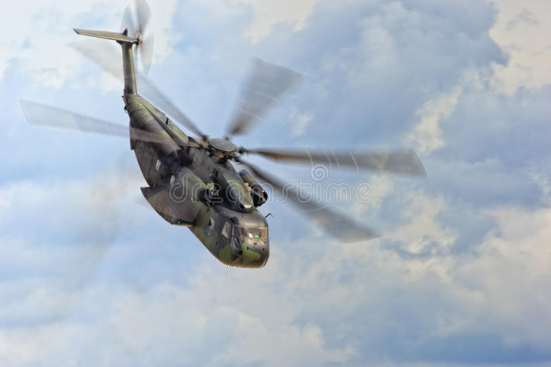 Military helicopter in flight stock photo