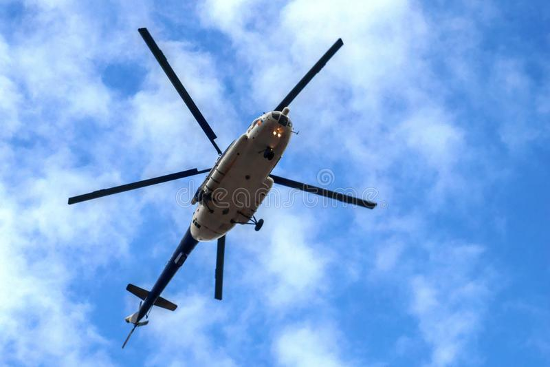 Military Helicopter flying on blue sky stock photography