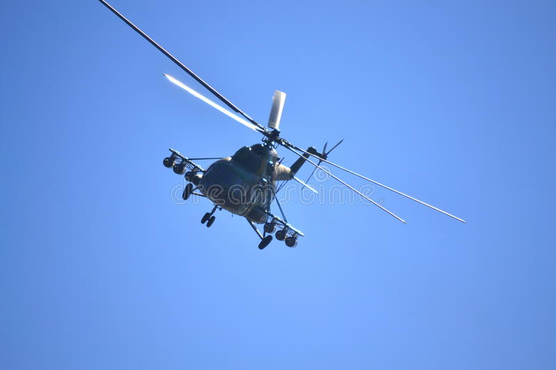 Military helicopter flying front view stock image
