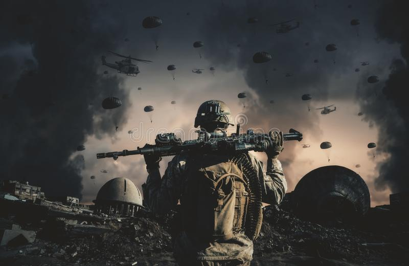 Military helicopters and forces in destroyed city stock photography