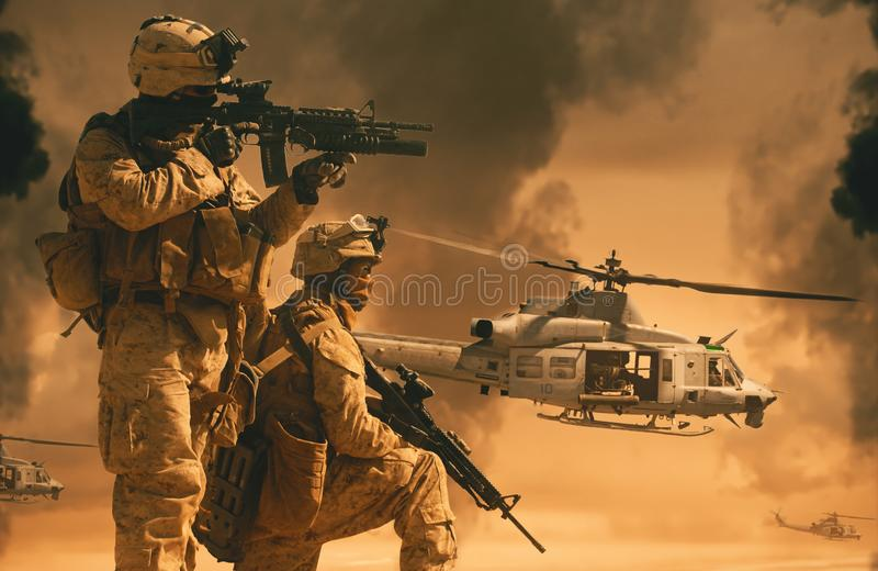 Military helicopters and forces between smoke royalty free stock photo