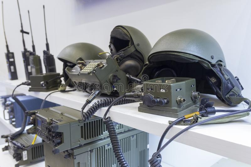Military helmet and electronics at the exhibition royalty free stock image