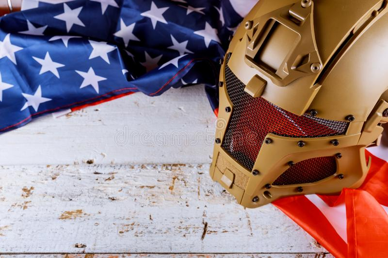 Military helmets and American flag on Veterans or Memorial day. Military helmets of United States flag on Veterans or Memorial day american army remembrance royalty free stock photos