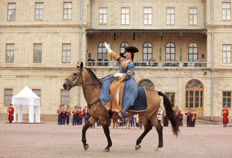 Military historical festival Gatchinskaya Byl. Gatchina, St. Petersburg, Russia - September 10, 2016: Actress in image of Empress Catherine II on a horse during stock photo