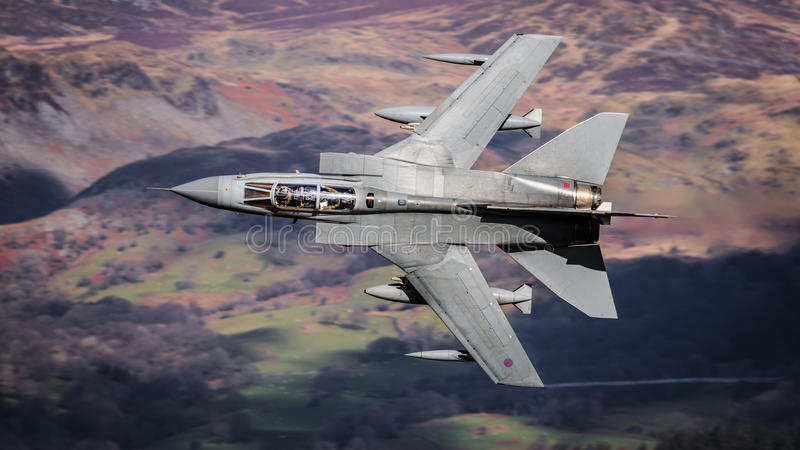 Military jet in flight stock photography