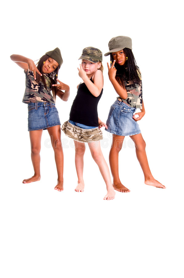 Military Kids For Peace. Two African American girls and one Caucasian dressed in denim skirts and military woodland camouflage tops and caps flashing peace signs stock photography