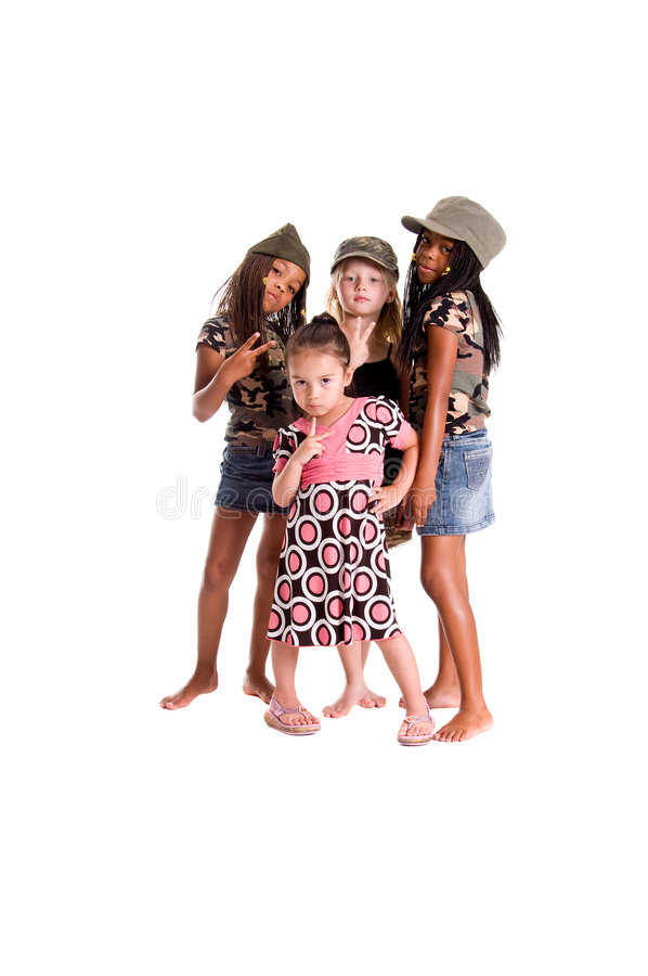 Military Kids For Peace. Multi-racial group of young girls dressed in skirts, dresses and military woodland camouflage tops and caps flashing peace signs stock photo