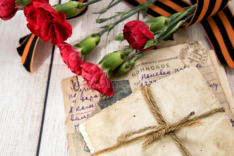 Military letter, old photos, carnations and Gergiev`s ribbon stock photos
