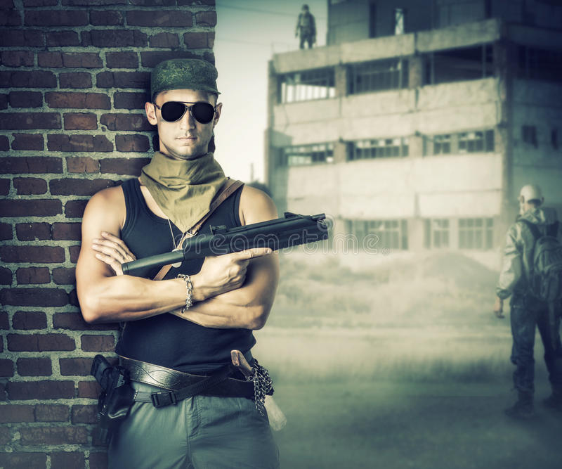Military man with gun - automatic stock image