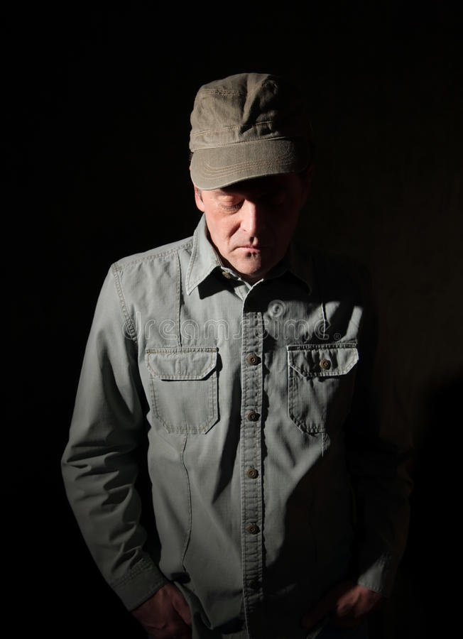 Military man with hands in pocket. Looking down royalty free stock photo