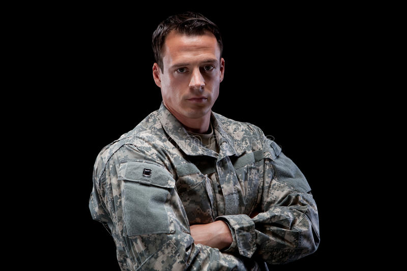Military man with his arms crossed stock image