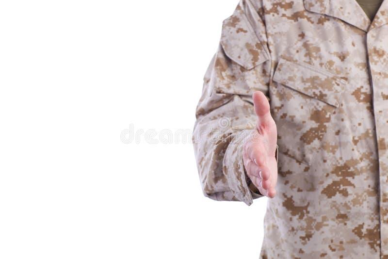 Military Man Offers Handshake stock photo