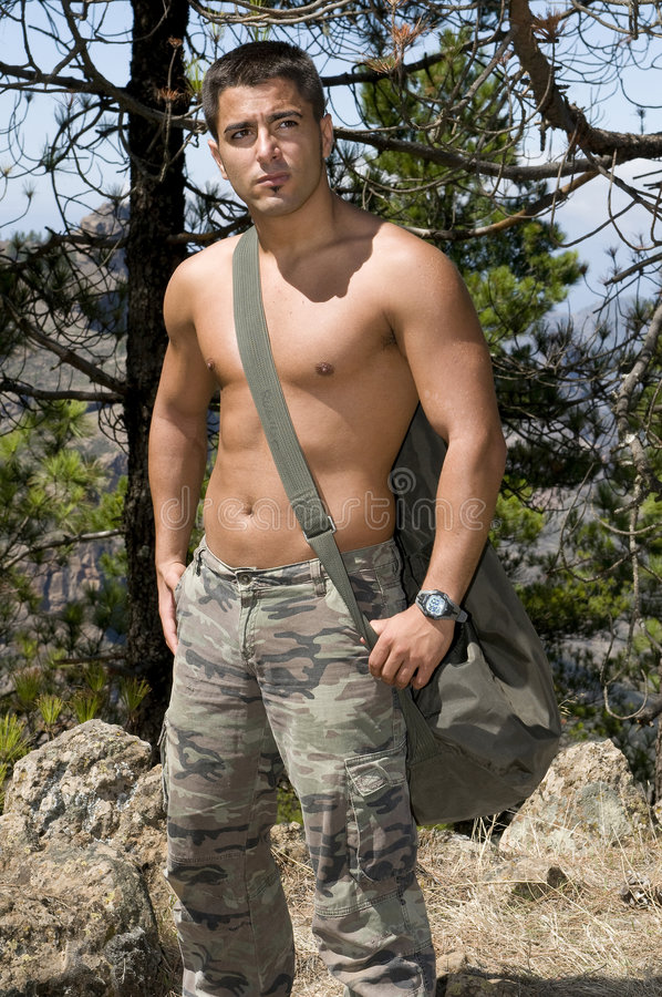 Military man relaxing without shirt stock photo