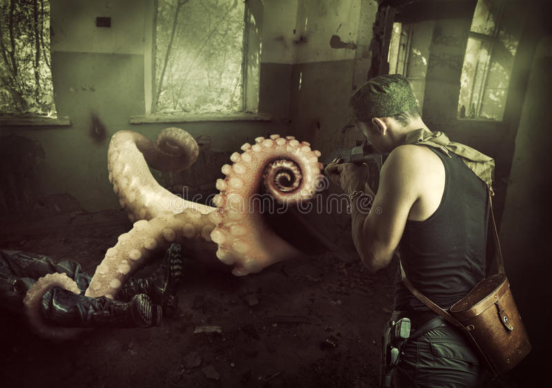 Military man shoots machine gun in octopus royalty free stock image