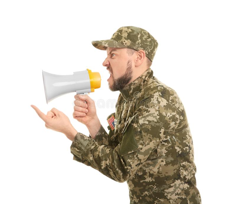 Military man shouting into megaphone. On white background royalty free stock photography