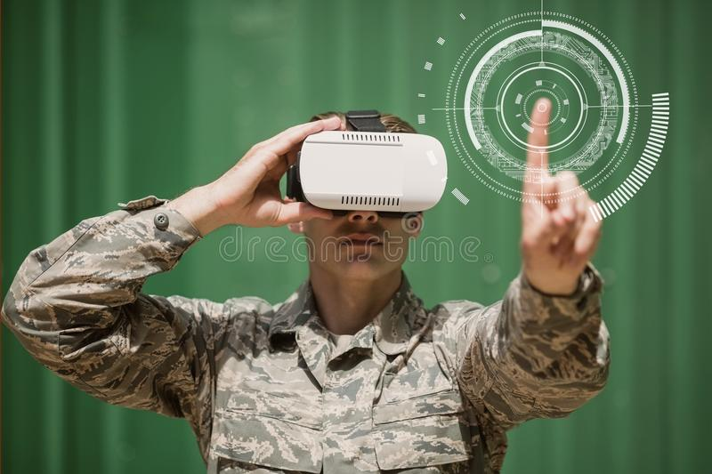 Military man in VR headset touching interface stock photo