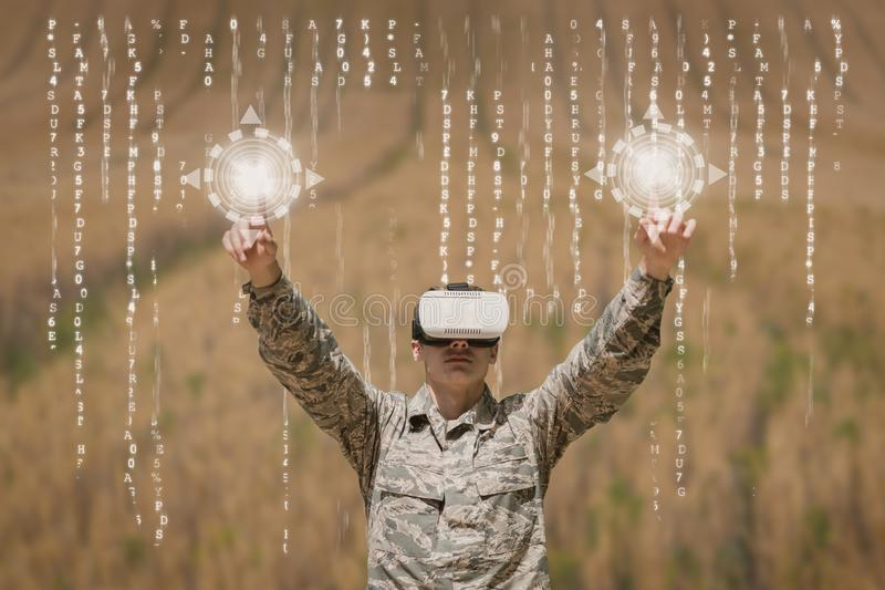 Military man in VR headset touching interfaces against field background with interfaces stock illustration