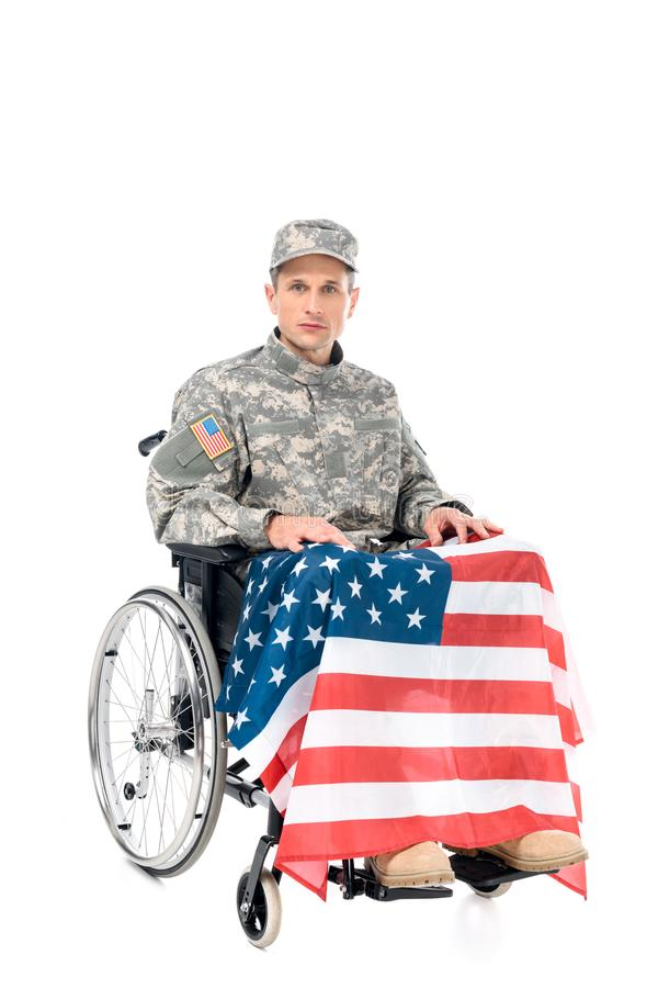 military man in wheelchair with usa flag royalty free stock photo