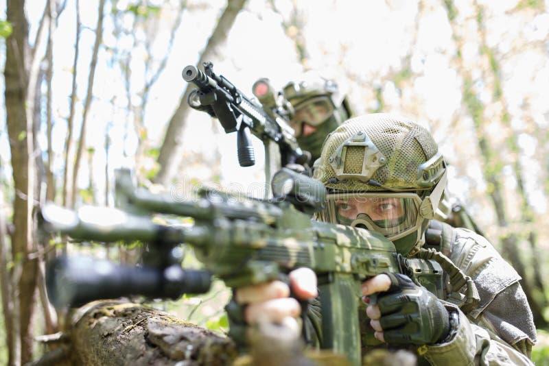 Military men with submachine gun stock photography