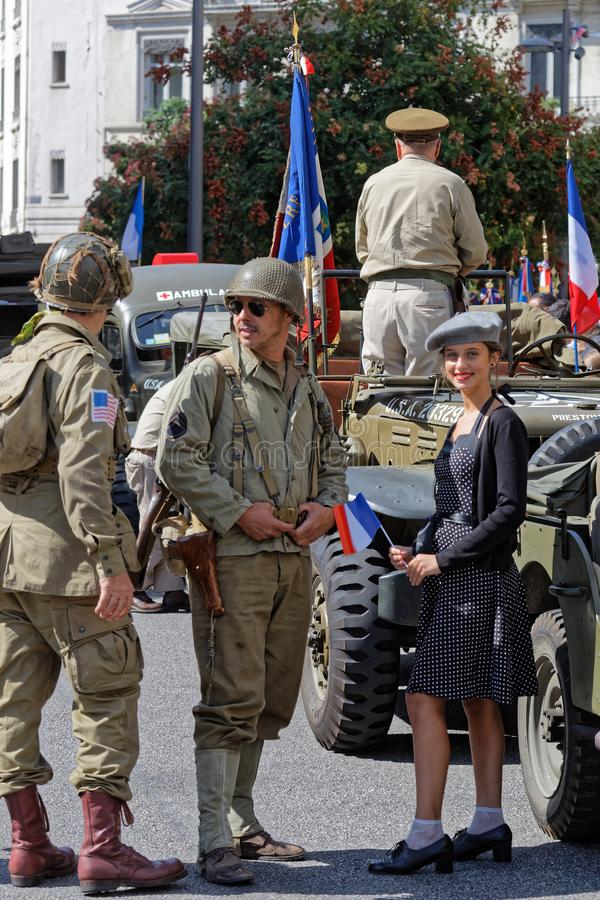 Military men, trucks and young woman in Lyon royalty free stock photos