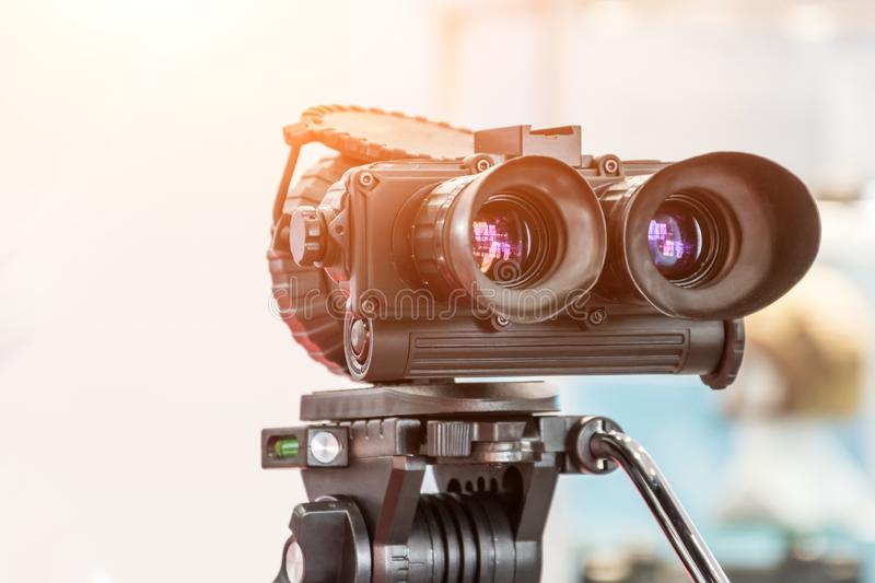 Military modern binoculars on a tripod, infrared and night vision stock photo