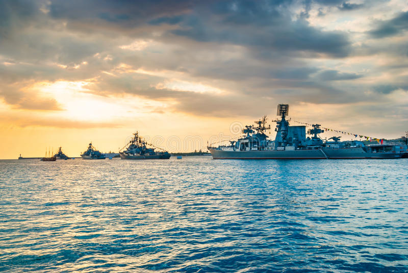 Military navy ships in a sea bay stock images
