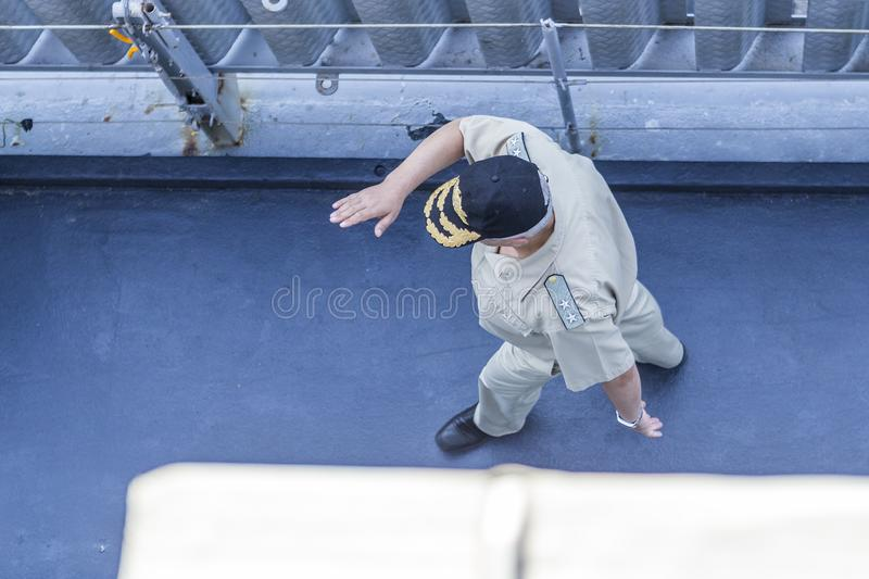 A Marine officer in uniform and a hat walking along the deck of a warship. Editorial use only. Burgas/Bulgaria/07.19.2018. A military officer on a military royalty free stock photos