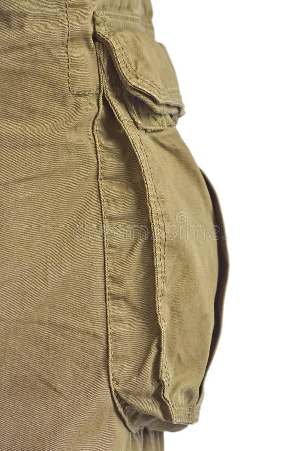 Military olive green army style cotton twill cargo pants storage. Pocket isolated macro closeup, large detailed camouflage trousers studio shot stock photography