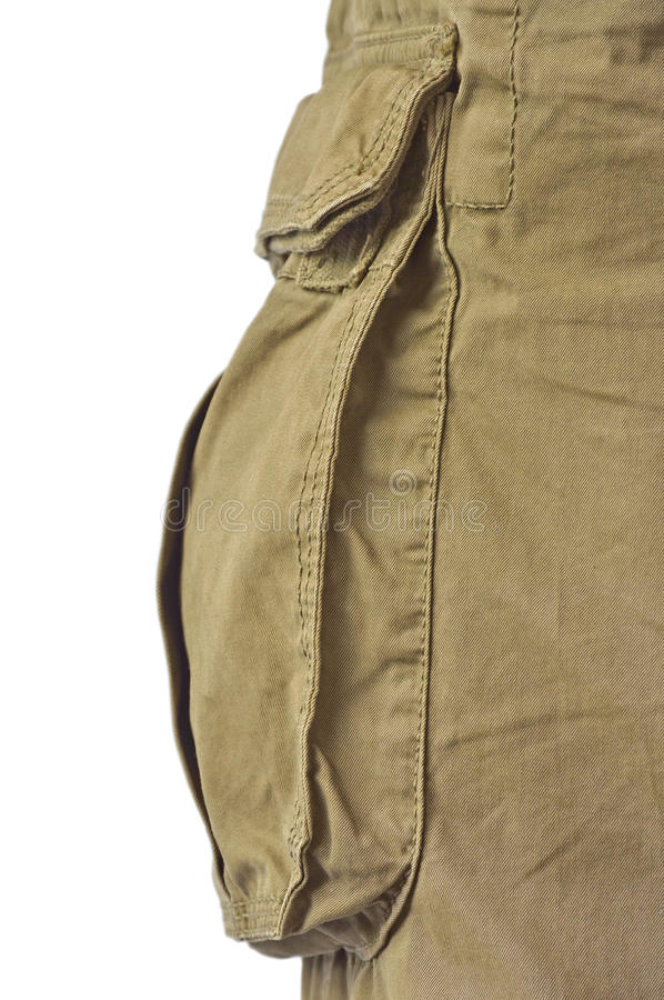 Military olive green army style cotton twill cargo pants storage pocket isolated macro closeup, large detailed camouflage trousers. Studio shot stock photo