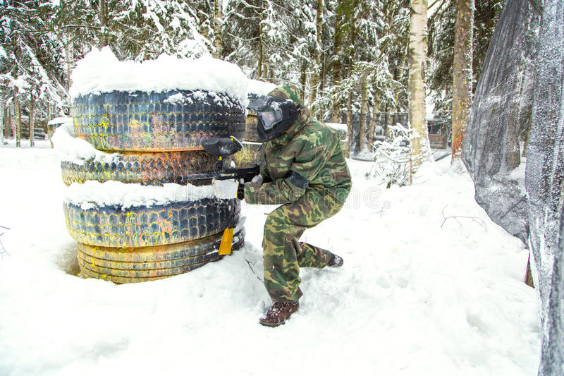 Military paintball training in winter with much snow royalty free stock images